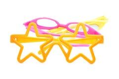 Orange plast- exponeringsglas - barns toy Arkivbild