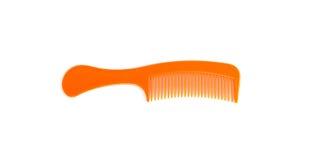 Orange plast- hårkam Royaltyfri Foto