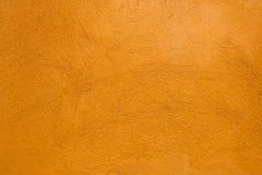 Orange plaster texture Stock Photos