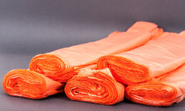 Orange plastic bags. Plastic bags on gray background Royalty Free Stock Images