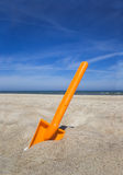 Orange plastic beache spade Royalty Free Stock Photography