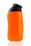 Orange plastic bottle Royalty Free Stock Photos