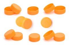 Orange plastic bottle cap on white background Stock Images