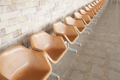 Orange plastic chair Royalty Free Stock Photos