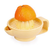 Orange plastic citrus juicer and orange Stock Images
