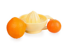 Orange plastic citrus juicer and oranges Stock Photography