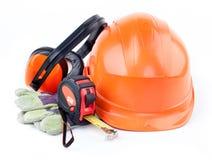 Orange plastic construction Helmet, roulette, gloves, headphones Royalty Free Stock Photo