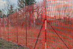 Orange plastic Construction Mesh Safety Fence. At the building site stock photos