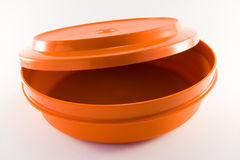 Orange Plastic Container. One orange plastic food container on a white background Royalty Free Stock Photos
