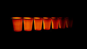 Orange plastic disposable cups, fading into the distance Royalty Free Stock Photography