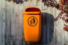 Orange plastic dust bin Stock Image