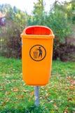 Orange plastic dust bin Stock Photo