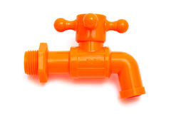 Orange plastic faucet Stock Photos