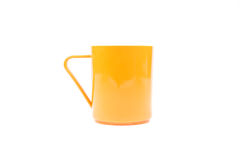 Orange plastic glass on a white background. royalty free stock images