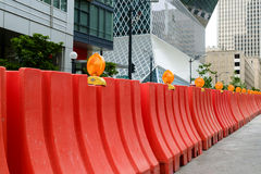 Orange plastic Jersey Barriers protect a construction site Royalty Free Stock Images