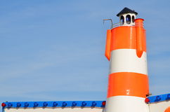 Orange plastic lighthouse in amusement park Royalty Free Stock Photos