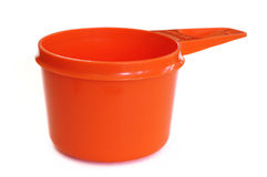 Orange Plastic Measuring Cup. Isolated on a White Background Royalty Free Stock Image