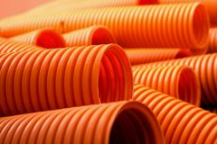 Orange plastic pipes on the construction Royalty Free Stock Photo