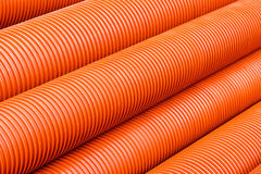 Orange plastic PVC pipes. Abstract industrial object concept Stock Images