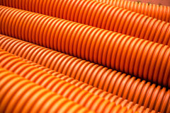 Orange plastic PVC pipes on industrial Royalty Free Stock Photography