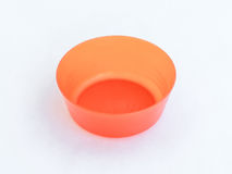 Orange plastic round medium size  bowl for loose products isolated on a white background Royalty Free Stock Photos