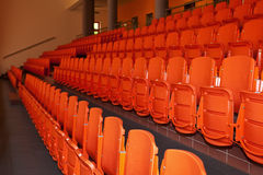 Orange, plastic seats. Stock Photo