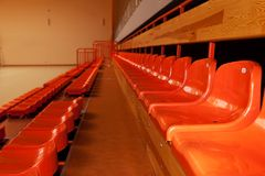 Orange, plastic seats in rows. Stock Photos