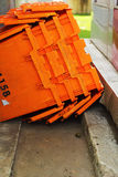 Orange plastic - stacked packing containers. Royalty Free Stock Photos