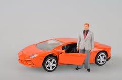 Orange plastic toy car isolated Royalty Free Stock Photography