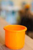 Orange plastic toy cup Royalty Free Stock Photography