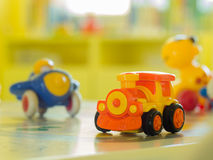 Orange plastic toy engine train and anither on a table Royalty Free Stock Photos