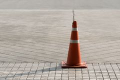 Orange Plastic traffic cone on the road Royalty Free Stock Photography
