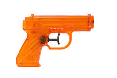 Orange plastic water pistol. Isolated on a white background Stock Photos