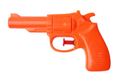 Orange plastic water pistol Royalty Free Stock Images