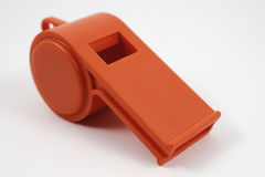 Orange plastic whistle Royalty Free Stock Photos