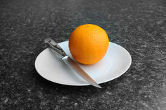 Orange on a plate Royalty Free Stock Photos