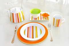 Orange plate Stock Images