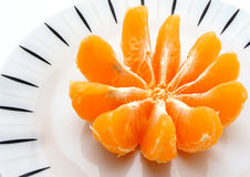 Orange in plate Stock Images