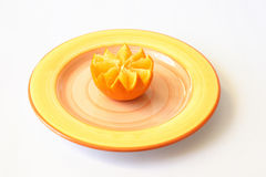Orange on plate. The Half of the orange on plate. Isolated Stock Photography