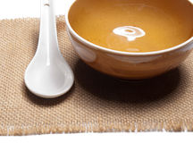Orange plate and china spoon Royalty Free Stock Photo