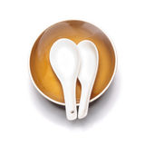 Orange plate and china spoon Stock Photography