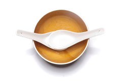 Orange plate and china spoon Royalty Free Stock Image