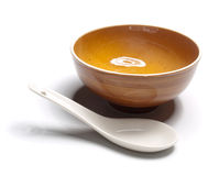 Orange plate and china spoon Stock Image