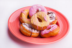 Orange plate of dougnuts Royalty Free Stock Photography