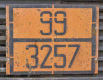 Orange plate with hazard identification number on bitumen tank Royalty Free Stock Image