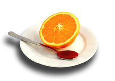 Orange on plate with spoon. Half of an orange on plate with metal spoon lying beside it Stock Photos