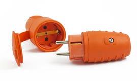 The orange plug and the socket on white. Background Stock Photo