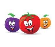Orange plum and tomato faces Stock Image