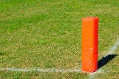 Orange fotbollpylon Arkivbild