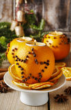 Orange pomander ball with candle. Christmas decor Royalty Free Stock Photography